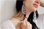 ribcage_earrings_model_3